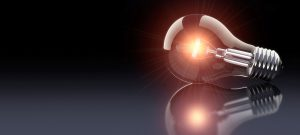 "A picture of a lightbulb sitting on a flat surface. This is used on our ""Ideas"" page."