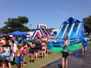 A photo of an inflatable water slide event at the holiday travel park, taken during the summer.